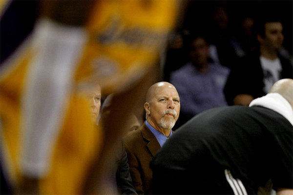 Lakers trainer Gary Vitti watches L.A. take on the Toronto Raptors.