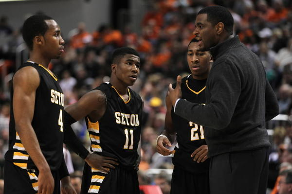 Seton head coach Brandon Thomas talks with Mark Weems, Jaylin Clemons (11) and Armahn Mooring during 62-37 win over Winnebago in IHSA Class 2A boys basketball state semifinal at Carver Arena in Peoria on Friday, March 8, 2013.