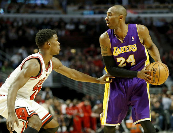 Chicago Bulls swingman Jimmy Butler defends Lakers guard Kobe Bryant.