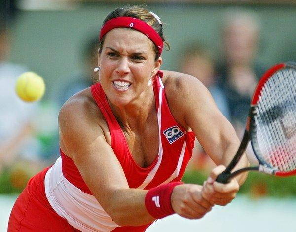 Jennifer Capriati, shown during the 2004 French Open, has been accused of several incidents involving battery and stalking her ex-boyfriend.