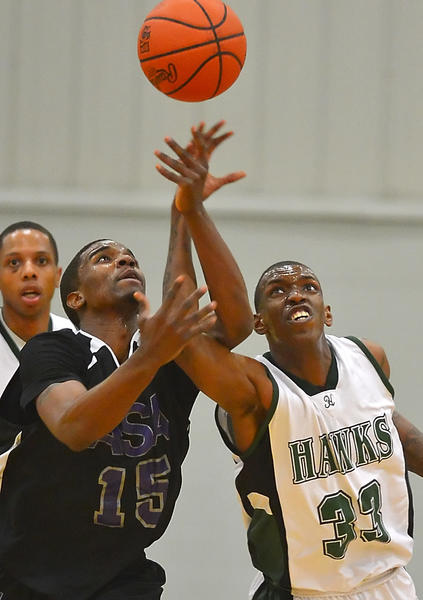 Hagerstown's Kervin Rameau (33) battles ASA College's Quillar Marion for a loose ball during Saturday night's NJCAA District III championship game at HCC.