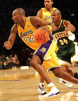 Lakers Kobe Bryant gets away from Seattle Supersonics Ray Allen at Staples Center Friday night.