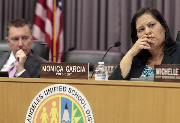 LAUSD Board President Monica Garcia, right, and Schools Superintendent John Deasy listen to deliberations at a board meeting.