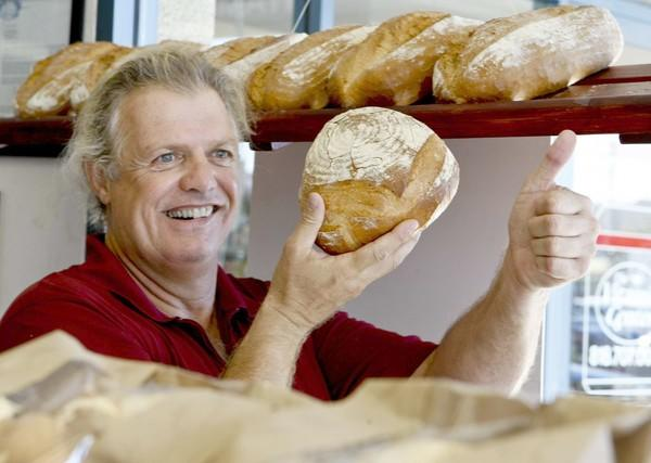 Abby Franke holds a loaf of freshly baked bread.  The German-born baker's StoneGround Bakery is known for kosher challah bread. Here's a behind-the-scenes look at the Agoura Hills bakery.