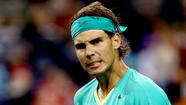 Rafael Nadal wore a bright aqua shirt and a scowl as he came onto Stadium 1 Court at the BNP Paribas Open on Saturday night to play his first hard-court tennis match in 346 days.