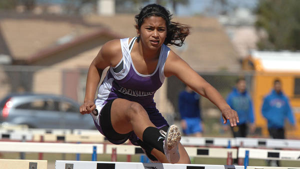 Southwest High's Jacqueline Mendez competes in the 100-meter high hurdles during the Desert Classic Relays Saturday afternoon at Central Union High in El Centro.