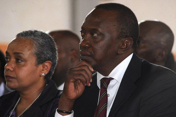 Kenya's president-elect, Uhuru Kenyatta, and his wife, Margaret Kenyatta, attend a mass at the Martyrs of Uganda Catholic church Sunday in Gatundu, Kenya. The election results are being disputed but calm has prevailed, in striking contrast to the aftermath of balloting in 2007.