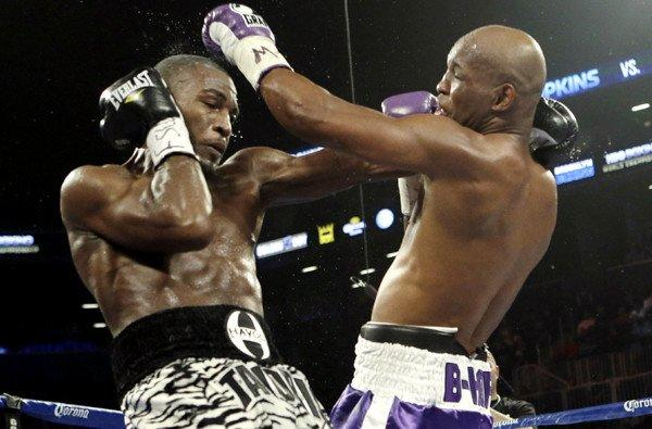 Bernard Hopkins lands a left against Tavoris Cloud in the fifth round of their IBF light-heavyweight fight on Saturday night at the Barclays Center in New York.