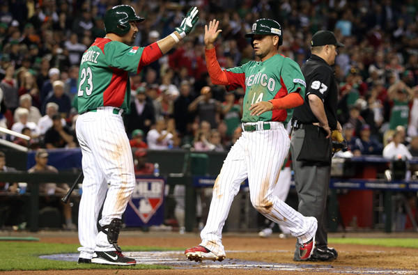 Adrian Gonzalez, left, greets Mexican squad teammate Eduardo Arredondo at the plate. With Mexico eliminated from the World Baseball Classic, Gonzalez will return to the Dodgers on Monday.