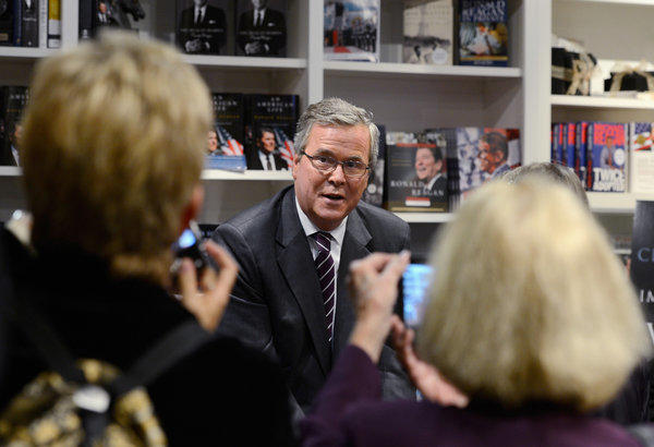 "Former Florida governor Jeb Bush autographs his new book ""Immigration Wars: Forging an American Solution"" before speaking at the Reagan Library."