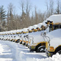 School buses covered in snow