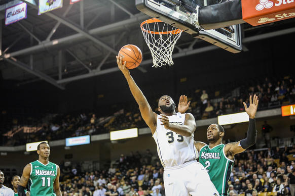 UCF's Keith Clanton (33) goes up to the basket during first half action of a NCAA basketball game against the Marshall at the UCF Arena in Orlando