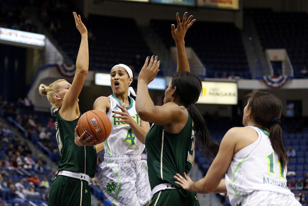 Notre Dame Fighting Irish guard Skylar Diggins (4) drives between South Florida Bulls guard Inga Orekhova, left, and center Akila McDonald in the second half during the quarterfinals of the Big East tournament at the XL Center. Notre Dame won, 75-66.