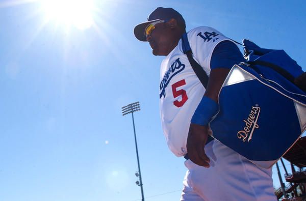 Dodgers infielder Juan Uribe arrives at Camelback Ranch for a spring workout last month.