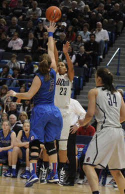 University of Connecticut forward Kaleena Mosqueda-Lewis shoots over DePaul Blue Demons guard Anna Martin during the first half Sunday.