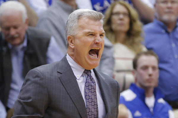 Kansas State coach Bruce Weber yells at the referees during the first half of a game against Kansas at Allen Fieldhouse.