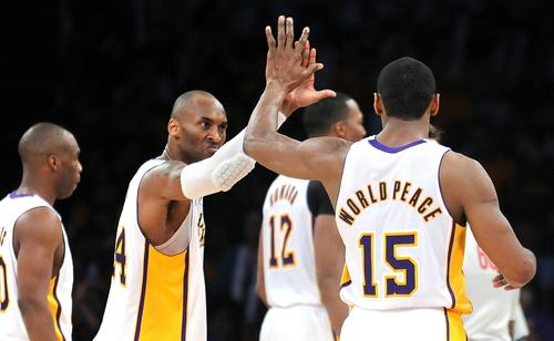 Lakers guard Kobe Bryant and forward Metta World Peace celebrate as they approach a victory over the Bulls on Sunday afternoon at Staples Center.