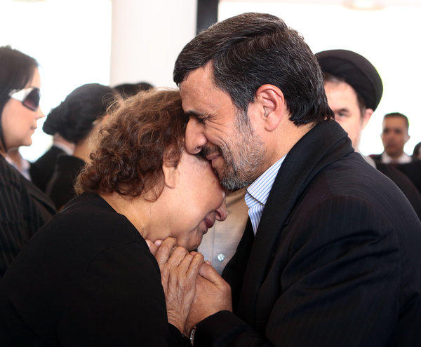Iranian President Mahmoud Ahmadinejad offers condolences to the mother of late President Hugo Chavez, Elena Frias de Chavez, during the Venezuelan leader's funeral Friday in Caracas, in a photo released by the press office of the Venezuelan presidency. The picture raised eyebrows in Iran because Islamic law dictates that a man should not touch a woman who is not a close relative.