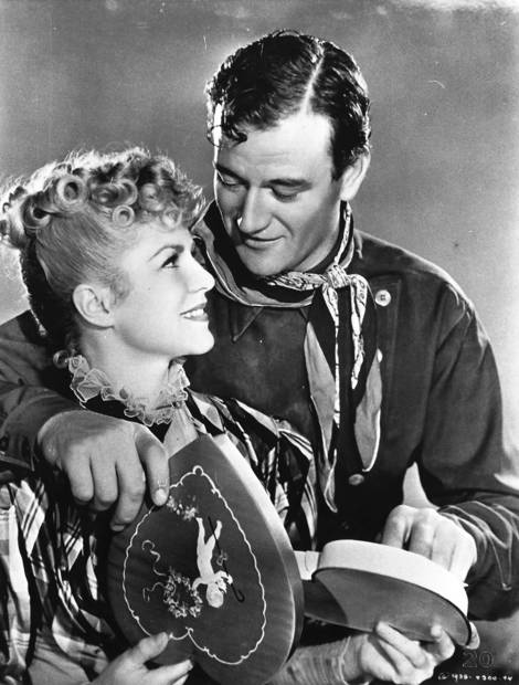 John Wayne, pictured with Claire Trevor, became a star in this landmark 1939 Western as the fugitive the Ringo Kid.