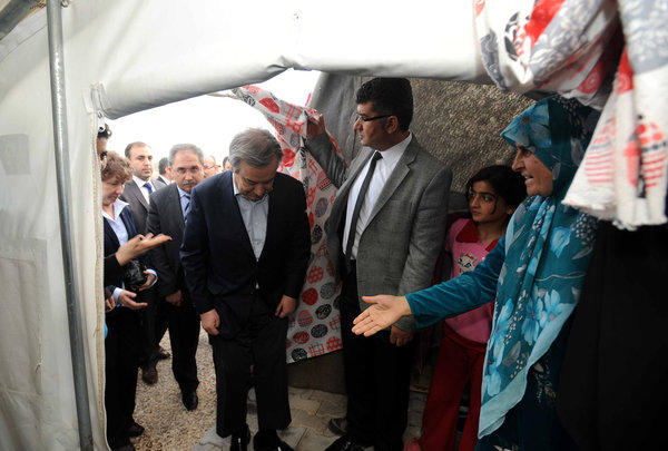 United Nations High Commissioner for Refugees Antonio Guterres, fourth from right, visits the Nizip refugee camp in Turkey on Sunday. The number of Syrian refugees, already past the 1-million mark, could double or triple by the end of the year if no solution is found to Syria's conflict, Guterres said.