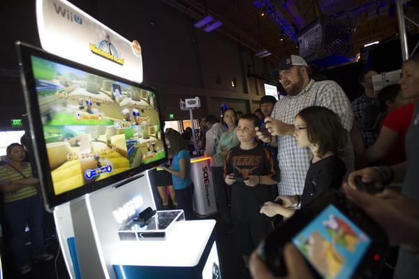 Attendees play Nintendo Wii video games.