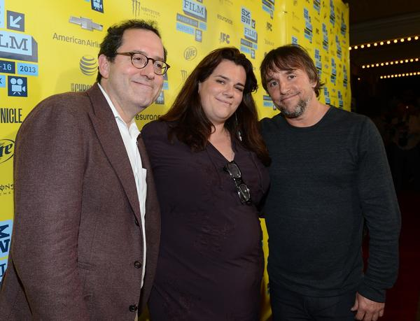 "Michael Barker, left, co-president and co-founder Sony Picture Classics, producer Sara Woodhatch and director Richard Linklater attend the screening for ""Before Midnight."""