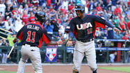 PHOENIX -- Adam Jones had three RBI and provided the go- ahead two-run double before the Americans broke it open in the ninth, as Team USA advanced to the second round of the World Baseball Classic by taking a 9-4 decision over Canada on Sunday.