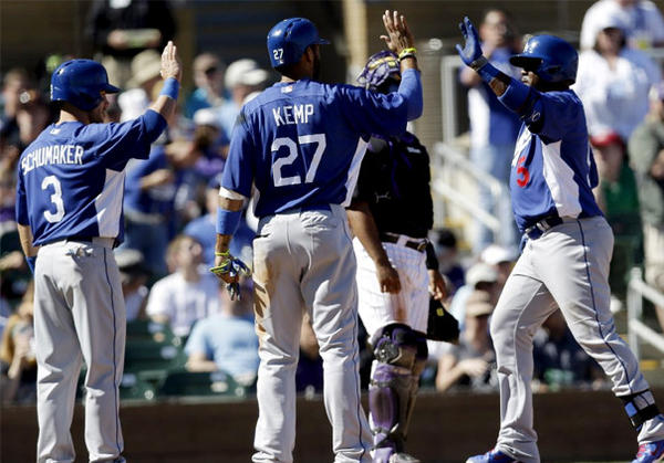 Dodgers' Juan Uribe, right, celebrates his three-run homer with teammates Matt Kemp and Skip Schumaker.