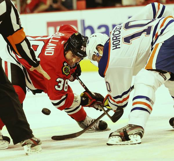 Dave Bolland in a face-off with the Oilers' Shawn Horcoff during the first period.