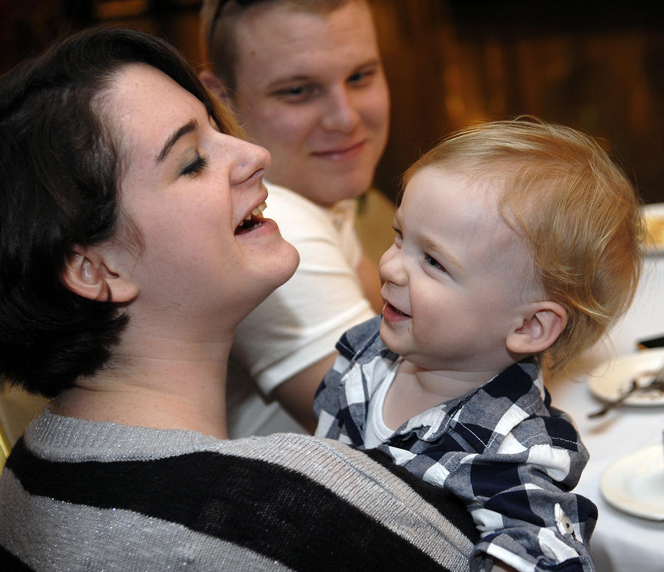 Brittany Nimmo Hurtt, left, shares a happy moment with her son Trevor Hurtt, 19 months, and her husband, Timothy Hurtt. Brittany Hurtt was a patient at Howard County General Hospital's Neonatal Intensive Care Unit in 1992.