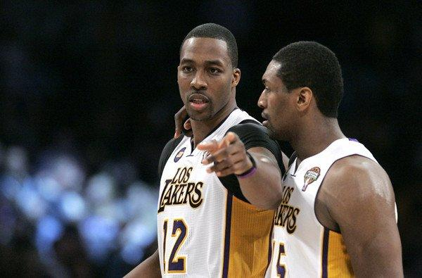 Lakers center Dwight Howard (12) and forward Metta World Peace discuss strategy.