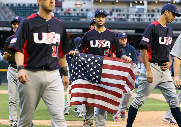 Ryan Braun carries a flag in celebration after defeating Canada 9-4 on Sunday.