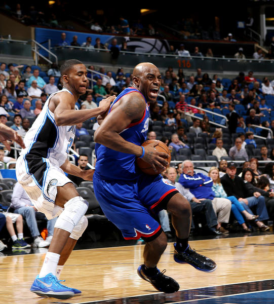 Orlando Magic forward Maurice Harkless, left, defends Damien Wilkins during their game against the Philadelphia 76ers at the Amway Center on Sunday, March 10, 2013.  The Magic won the game 99-91.(Jacob Langston/Orlando Sentinel).