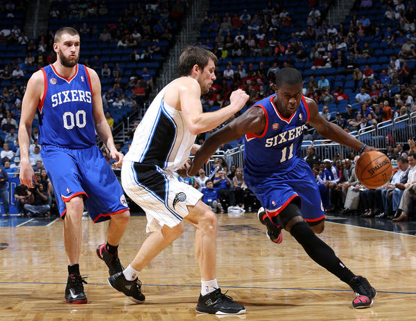 Orlando Magic guard Beno Udrih defends Jrue Holiday as Holiday goes around a pick set by Spencer Hawes, left, during their game against the Philadelphia 76ers at the Amway Center on Sunday, March 10, 2013.  The Magic won the game 99-91.(Jacob Langston/Orlando Sentinel).