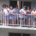 Homeowners watch the Air and Sea Show from their condo
