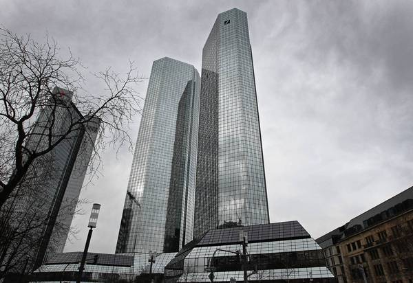 Deutsche Bank, now the world's largest, settled with the Federal Deposit Insurance Corp. to resolve claims that subsidiary MortgageIT sold shaky loans to IndyMac Bank, which imploded under the weight of risky mortgages and construction loans. The FDIC collected $54 million from the settlement three years ago but never issued a news release to announce it. Above, the Deutsche Bank towers in Frankfurt, Germany.
