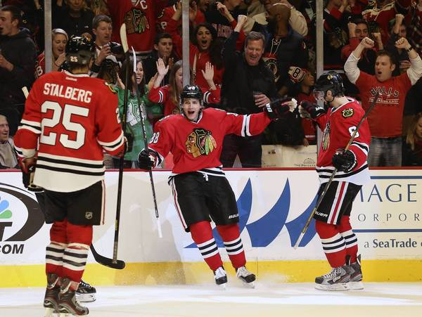Patrick Kane celebrates his goal against the Oilers during the third period.