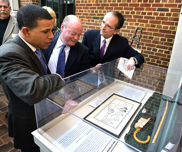 Md. Lt. Gov. Anthony G. Brown, left, and Del. John P. Donoghue, D-Washington, listen as Bruce Poole, right, describes events surrounding the trial of William Zantzinger in the death of Hattie Carroll. Poole's father, David Poole, was part of prosecution team. Artifacts from the case were on display Sunday during a ceremony at the Washington County Museum of Fine Arts marking the trial's 50th anniversary.