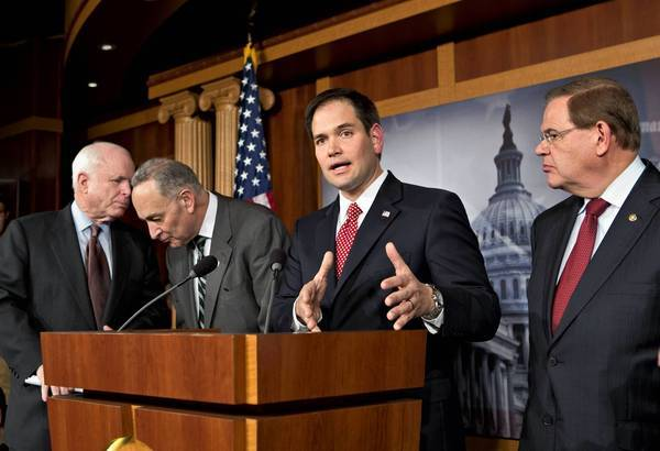 Sen. Marco Rubio (R-Fla.) speaks to journalists in January about a bipartisan immigration reform effort being undertaken by eight senators. With him are Sens. John McCain (R-Ariz.), left, Charles E. Schumer (D-N.Y.) and Robert Menendez (D-N.J.).