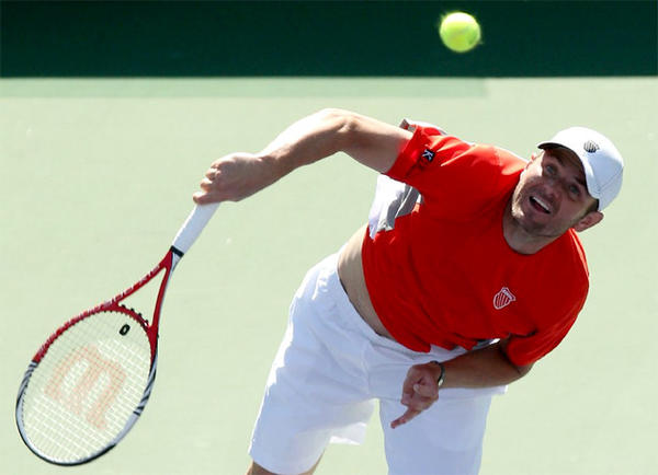 Mardy Fish beats Bobby Reynolds, 6-3, 3-6, 6-4, at the BNP Paribas Open in his first singles match in 189 days because of a heart issue.