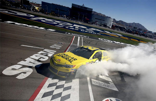 Matt Kenseth celebrates with a burn out after winning the NASCAR Sprint Cup Series race at Las Vegas Motor Speedway.