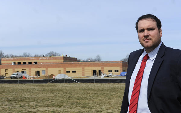 John Thompson, assistant principal at Phoenix Center Annapolis, has been named principal at Phoenix Academy, an alternative school. He's shown outside the new school, which is under construction.