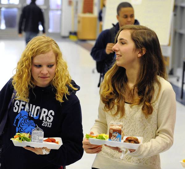 Laura Harrison, left, and Katherine Elicker buy lunch at Howard High School. The Howard County School System has received the USDA's HealthierUS School Challenge Award for its practices in nutrition.