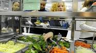 Students at Howard High School emerge from cafeteria lines with plates as green as well-manicured lawns. They reach for steamed broccoli and fresh lettuce as quickly as they do macaroni and cheese and popcorn chicken. And they say they their healthful eating habits extend beyond school hours.