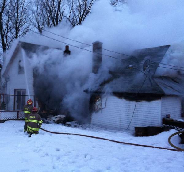 Boyne City Fire Department firefighters battle a house fire as of 8 a.m., today, Monday, at 4118 Old Horton Bay Road near Boyne City. Three people and the family dog safely evacuated the residence, calling 9-1-1 at approximately 7:10 a.m. Also responding to the scene were Boyne City EMS, Melrose Township Fire Department, Boyne Valley Township Fire and Rescue, and the Charlevoix County Sheriff's Office. Here, firefighters are seen battling the blaze.