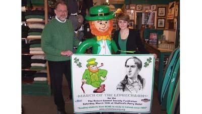 "Robert Emmet Society vice chairman and County Emmet Celtic Shop owner Ed Karmann (left) and County Emmet employee Holly August are shown with one of the inflatable figures to be featured Thursday, March 14, in ""March of the Leprechauns"" along downtown Petoskey streets."