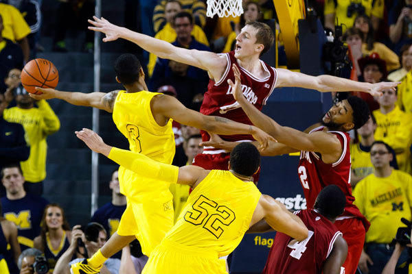 Michigan Wolverines guard Trey Burke (3) tries to score in the final seconds of the second half on Indiana Hoosiers forward Cody Zeller (40) at Crisler Center.
