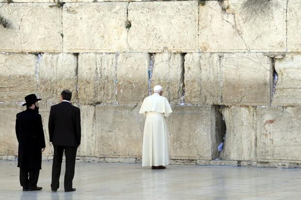 In 2009, Pope Benedict XVI stands next to the Western Wall, Judaism's holiest site, in the Old City of Jerusalem.