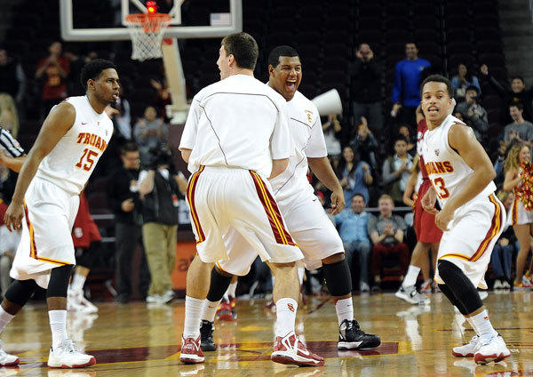 USC Trojans players celebrate the win over Stanford Cardinal at the Galen Center.