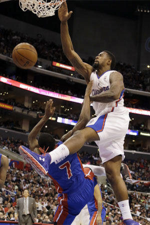 DeAndre Jordan dunks on Detroit's Brandon Knight during the second quarter of the Clippers' 129-97 victory at Staples Center.